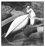 Photo: Canoes, Woman Snapping Picture